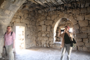 Bethany and Colleen exploring the room where Lawrence of Arabia stayed in Qasr Azraq